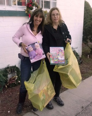 Cindy Shadron, Executive Director of The Forgotten Ones, Inc. alongside of Mrs. Cynthia from The Oviedo Family Dollar Store.